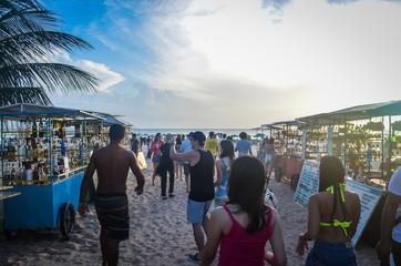 People walking on Jericoacoara beach during sunset