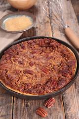 pecan pie on wood background