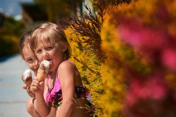 Two little girls eating ice-cream