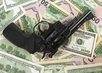 black revolver on money hundred dollar bill. gun