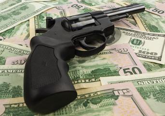 black revolver on money