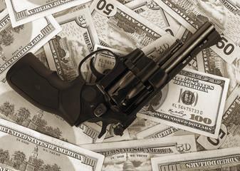 black revolver on money hundred dollar bill. black and white
