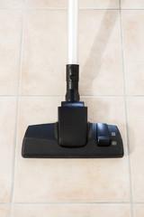 Vacuum cleaner on kitchen floor (vertical edit)