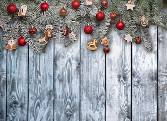 Christmas fir tree with decoration on planks background