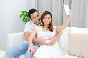 Asian pregnant woman and husband