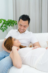 Asian man and his pregnant wife