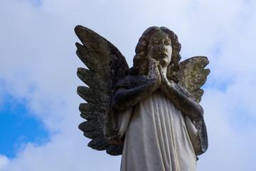 Praying Angel Statue under Blue Sky