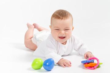 Baby newborn in the shirt closeup on white background.