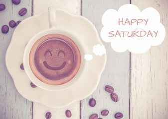 Happy Saturday with coffee cup on table