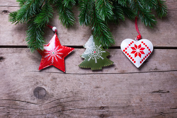 Spruce branches  and Christmas decorations on  vintage  wooden b