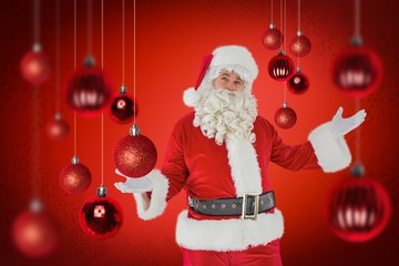 Composite image of father christmas with his hands out