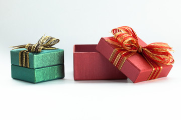 Red festive gift box being opened and left on the side.