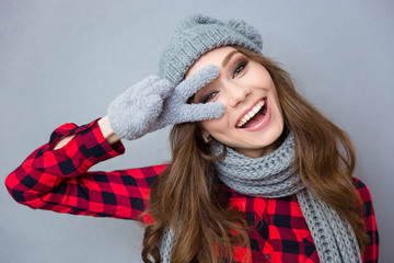 Laughing woman showing two fingers sign