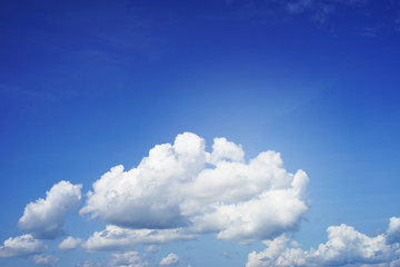 fluffy white cloud on blue sky