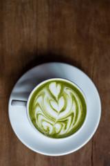 Matcha Green Tea Latte on Wooden Background