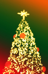 Multicolored defocused bokeh lights christmas tree background co