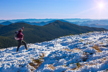 One Hiker Walking on Snow and Ice Terrain Wide Mountain View
