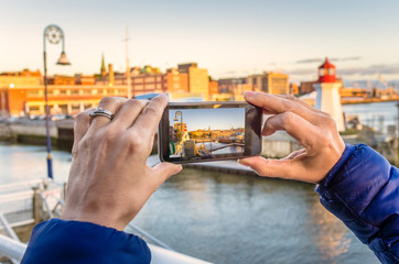 Taking a Picture of the Waterfront with a Smartphone. Saint John, NB, Canada