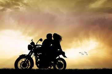 couple kissing on motorbike