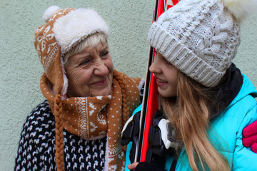 Grandmother and  girl in ski holidays