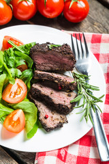 Steak with vegetables and sauce