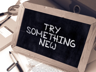 Try Something New - Inspirational Quote on Chalkboard.