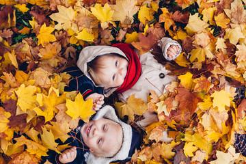 Kids Enjoy in Autumn Leaves