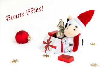 "The plush caw in the christmas cap with gift box. / Text ""Bonne Fetes"" easy removable."