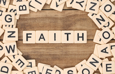 Faith spelled out in tan tile letters