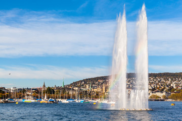 Fountain with rainbow on Zurich lake