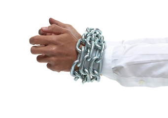 Businessman's hands chained together