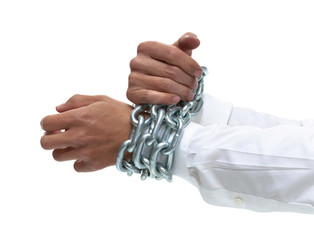 Businessman's hands chained together tightly