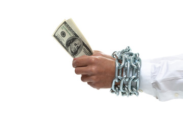 Businessman's hands chained holding money