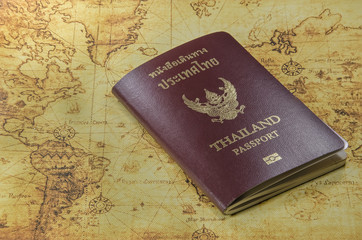 thailand passport on a old world map