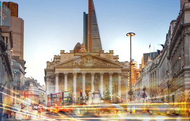 Royal stock exchange building view with traffic lights reflections, London