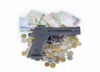 handgun on thai money banknotes and coins