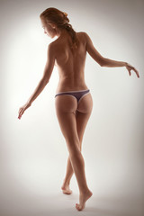 girl in panties on a white background