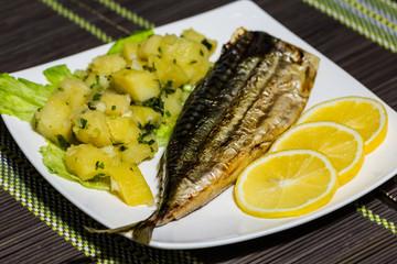 Grilled mackerel with potato salad and lemon