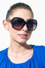 young woman with blue dress in sunglasses