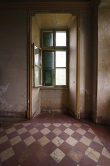 Old window in an abandoned room