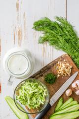 Tarator ingredients on white wood background