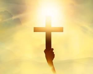 Leinwandbilder - Silhouette the cross in hand, religion symbol in light and lands