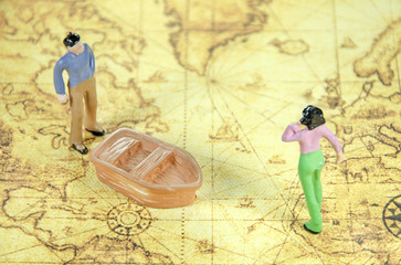 mini model of a man woman on a old world map