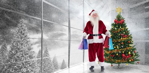 Composite image of santa carries some christmas bags