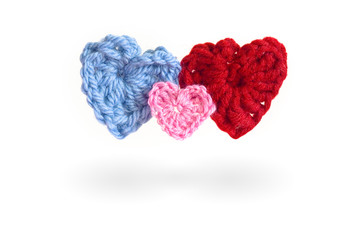 Three red knit hearts as a symbol for a family. Mom, Dad and Baby - happy valentine heart family