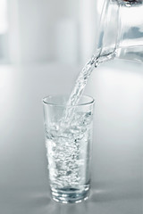 Drinking Water. Pour Water From Pitcher Into A Glass. Health, Diet, Hydratation Concept.
