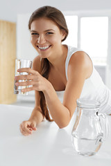 Beauty, Diet Concept. Happy Smiling Woman Drinking Water. Health