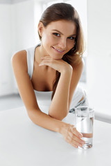 Healthy Lifestyle. Happy Woman With Glass Of Water. Drinks.
