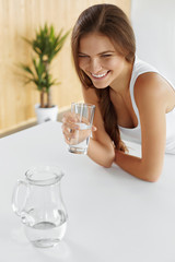 Drinks. Happy Girl Drinking Water. Healthcare. Healthy Lifestyle. Dieting, Beauty Concept.