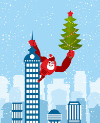 Big Red Gorilla dressed as Santa Claus climbs the building with